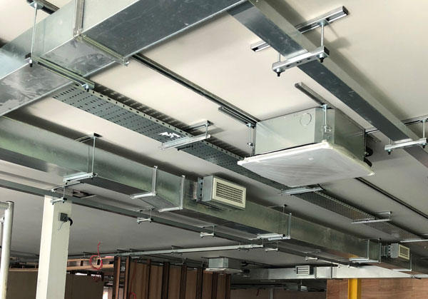 Various ventilation outlets in a ceiling